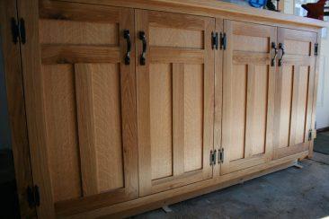 Arts & Crafts style oak base cabinets