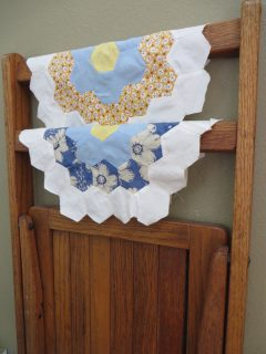 Antique folding chair and two quilt blocks